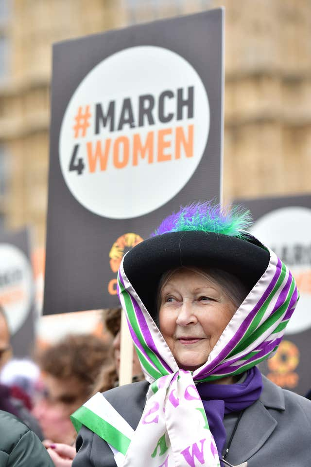 One marcher channelled the spirit of the Suffragettes, sporting the colours and style of the Votes For Women movement (Dominic Lipinski/PA)