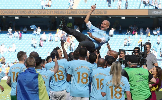 Pep Guardiola is thrown in the air by his players as Manchester City celebrate the 2017-18 title