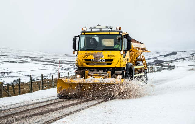 A gritter lorry at work in snowy conditions (Danny Lawson/PA)