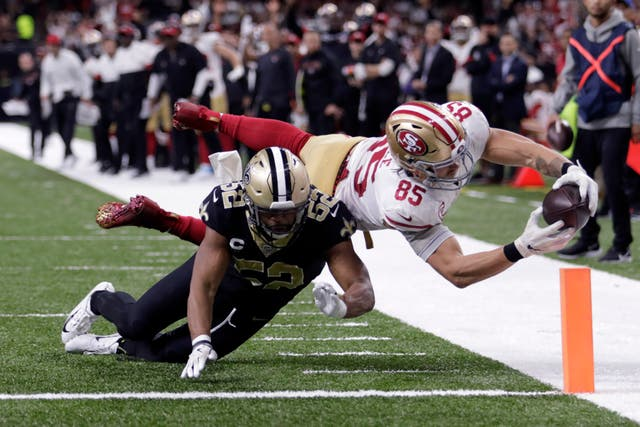 San Francisco 49ers tight end George Kittle had to stretch to score a touchdown as his side edged out the New Orleans Saints 48-46