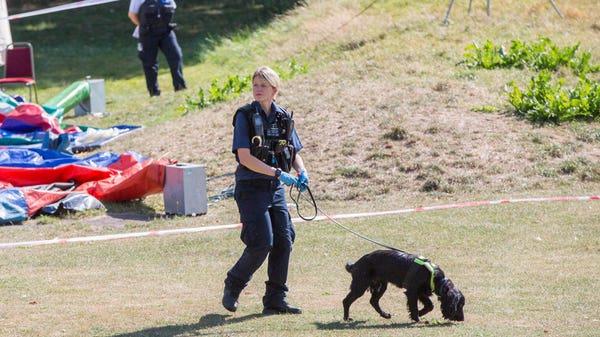 Revellers restrain suspected killer by sitting on him until police arrive