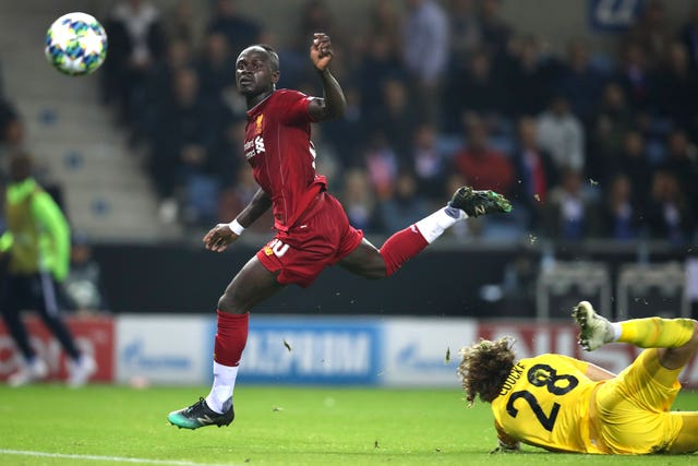 Sadio Mane, centre, on his way to scoring Liverpool's third goal