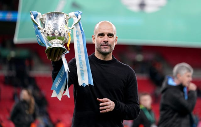 Pep Guardiola with the Carabao Cup trophy earlier this month