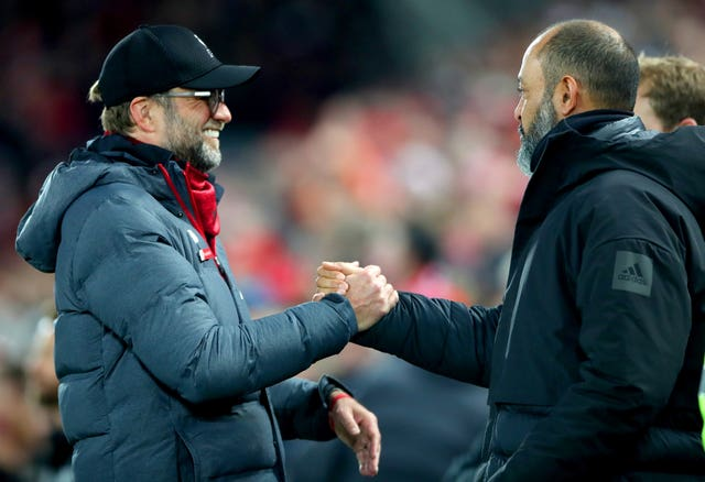 Liverpool manager Jurgen Klopp (left) and Wolves manager Nuno Espirito Santo