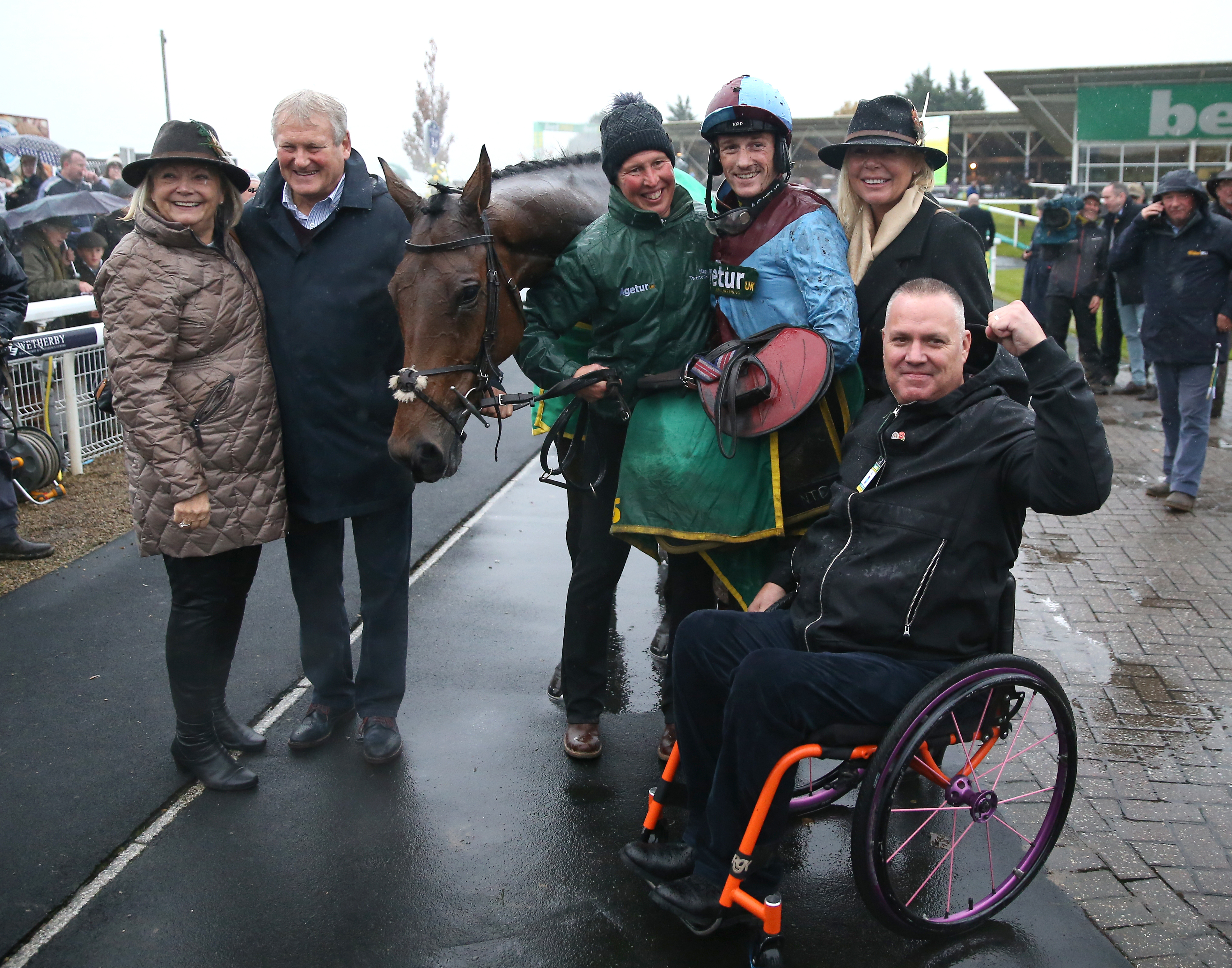 Winning connections of Ballyoptic - all smiles in the Wetherby rain