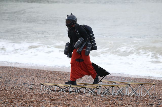 Richard Browning in his body-controlled, jet engine-powered suit near Brighton Pier