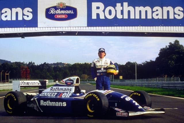 Ayrton Senna stands by his new Rothmans Williams Renault during testing in Portugal in 1994