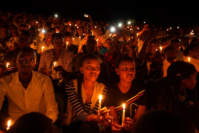 People attend a candlelit vigil during a memorial service marking 25 years since the genocide, at Amahoro stadium in the capital Kigali, Rwanda, in 2019