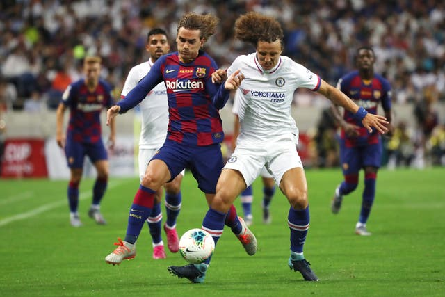 David Luiz, right, and Barcelona's Antoine Griezmann, left, compete for the ball