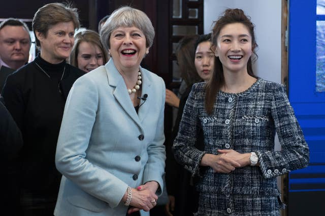 Mrs May is greeted by Chinese actress Jiang She Ying at Wuhan University (Stefan Rousseau/PA)