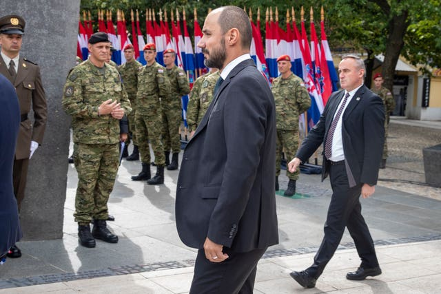 Croatia's deputy prime minister Boris Milosevic arrives at the ceremony (Darko Bandic/AP)