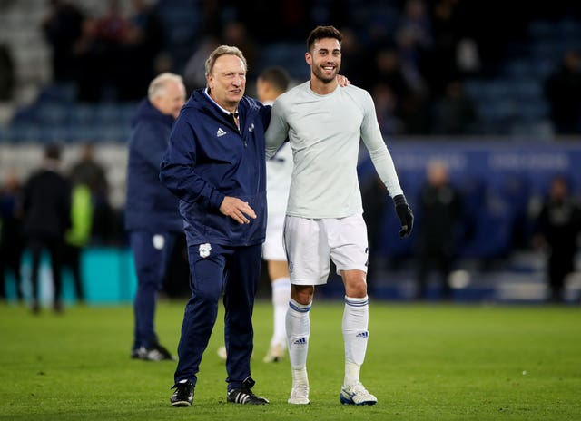 Cardiff manager Neil Warnock (left) and midfielder Victor Camarasa (right) (PA)