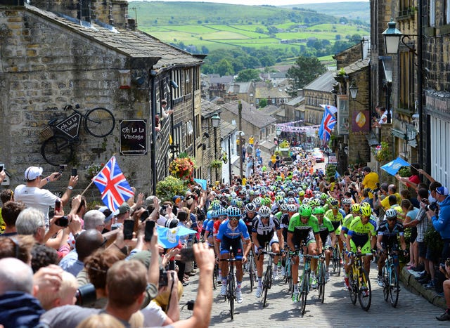 Crowds line the streets of Haworth, West Yorkshire to cheer on the Tour de France peloton during its route from York to Sheffield. Yorkshire hosted the opening two stages of the annual race in 2014, which was won by Italian rider Vincenzo Nibali