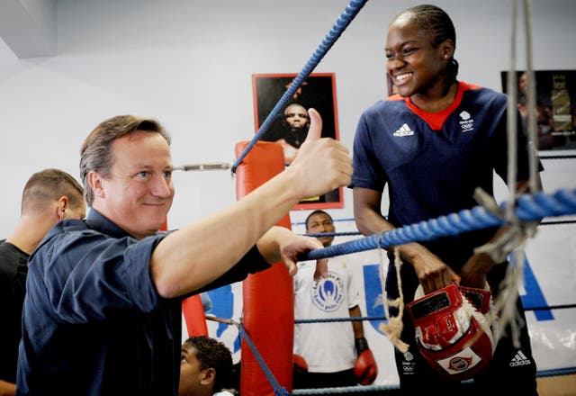 Adams met then-Prime Minister David Cameron during a training session in Brazil