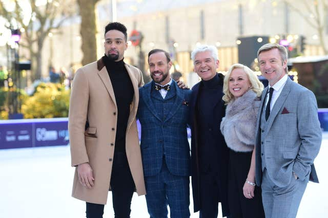 Presenter Phillip Schofield (centre) with judges (left to right) Ashley Banjo, Jason Gardiner, Jayne Torvill and Christopher Dean at the Natural History Museum ice rink