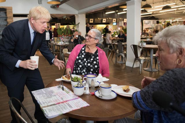 Conservative Party leadership contender Boris Johnson meets customers during a visit to Polhill Garden Centre near Halstead in Kent