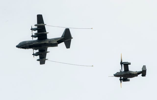 A Hercules (left) and an Osprey