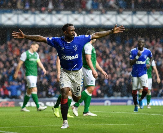 Jermain Defoe grabbed a hat-trick as Rangers crushed Hibs on Sunday