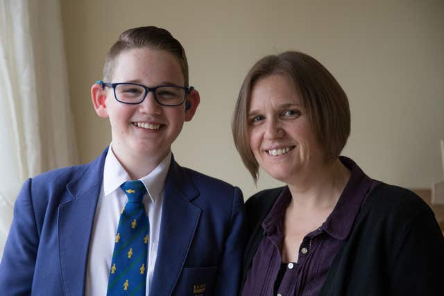 Jacinta Litherland from Derby with her son Reuben Litherland, 14, who was born deaf and has started lunchtime lessons to teach sign language at his school, and who is amongst those who have received an invitation to the wedding of Prince Harry and Meghan Markle at Windsor Castle (Aaron Chown/PA)