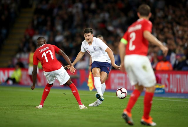 England's Harry Maguire (centre).