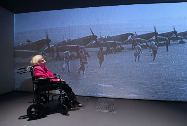 Ann Galley watches a video wall of planes
