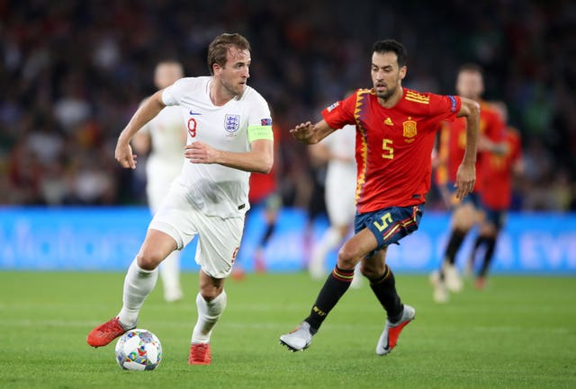 England's Harry Kane (left) and Spain's Sergio Busquets. (PA)