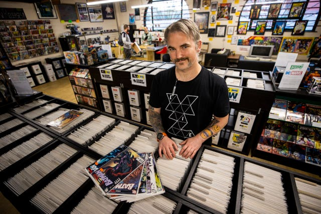 Owner Allan Taylor inside Coffee & Heroes comic book store and coffee shop in Belfast's Smithfield Market (Liam McBurney/PA)