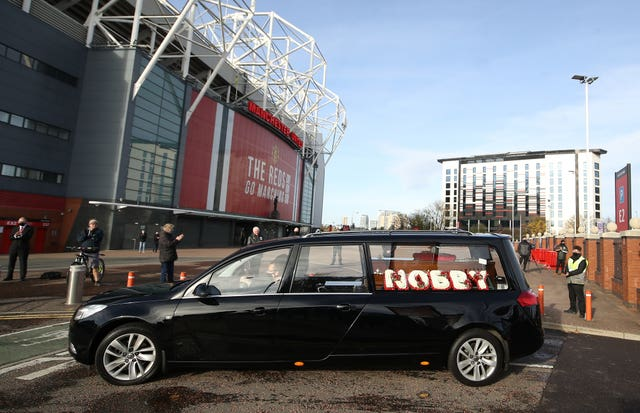 The hearse made its way  past Old Trafford before the service at Manchester Crematorium Southern Cemetery