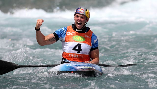 Great Britain's Joseph Clarke celebrates victory in the Canoe Slalom World Cup
