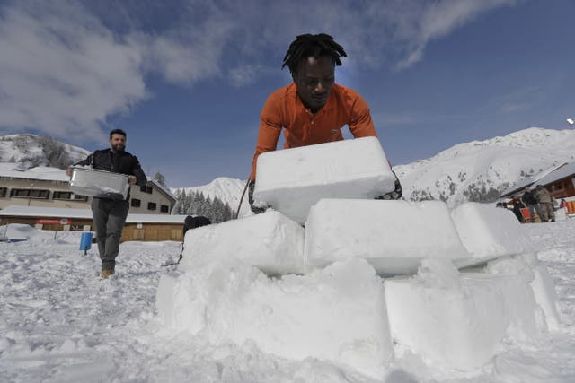 Igloos warm hearts in old Alps ski town where migrants reside | St