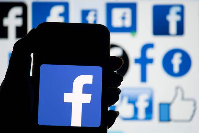 The logo of Facebook displayed on a smartphone (Dominic Lipinski/PA)
