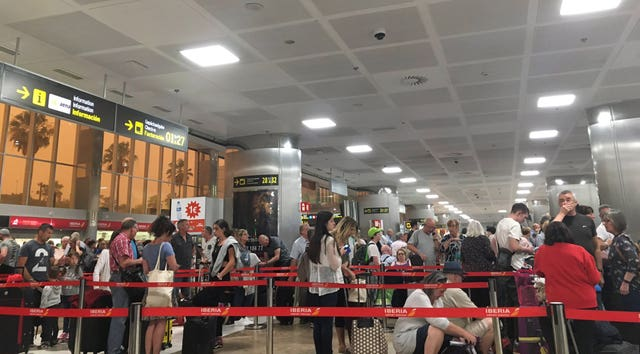 Passengers queuing at Tenerife South airport