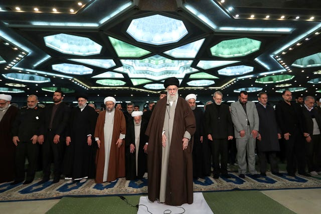 Iranian Supreme Leader Ayatollah Ali Khamenei, center, leads Friday prayers at Imam Khomeini Grand Mosque in Tehran