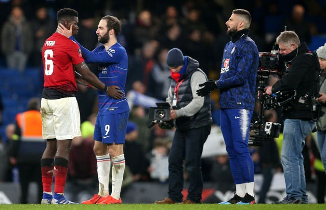 Manchester United's Paul Pogba and Chelsea's Gonzalo Higuain embrace