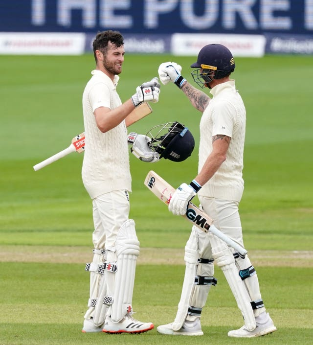 England's Dom Sibley celebrates with Ben Stokes after making his century