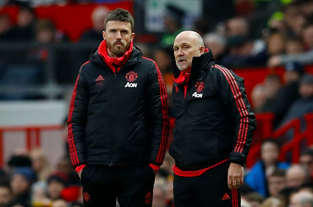 Manchester United coaches Michael Carrick, left, and Mike Phelan were not in the dugout at Old Trafford