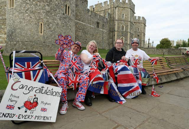 Royal fans gathering outside Windsor Castle ahead of the wedding (Steve Parsons/PA)