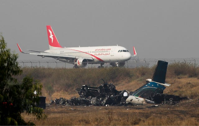 The wreckage of Bangladesh's US-Bangla Flight BS211 at Tribhuvan International Airport in Kathmandu (AP Photo/Niranjan Shrestha)