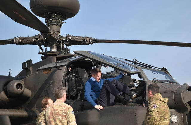Defence Secretary Gavin Williamson climbs out of the cockpit of an Apache helicopter at Wattisham Airfield in Suffolk