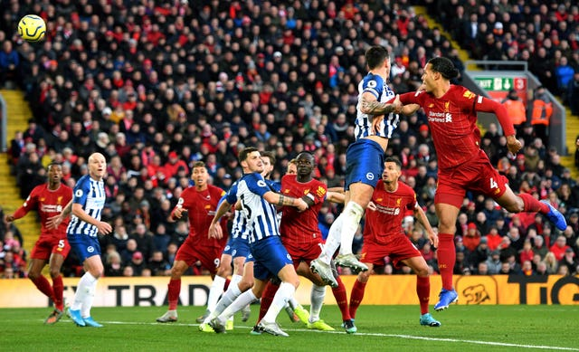 Virgil Van Dijk scored twice to give Liverpool victory over Brighton, moving them eight points clear at the top of the Premier League table