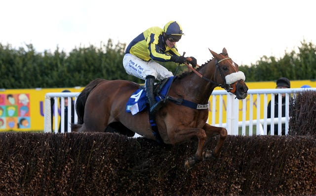 The Last Samuri and David Bass clear the final fence on their way to winning The BetBright Grimthorpe Chase at Doncaster