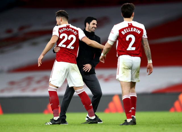 Arsenal have eased the pressure on Mikel Arteta (centre) with three successive wins