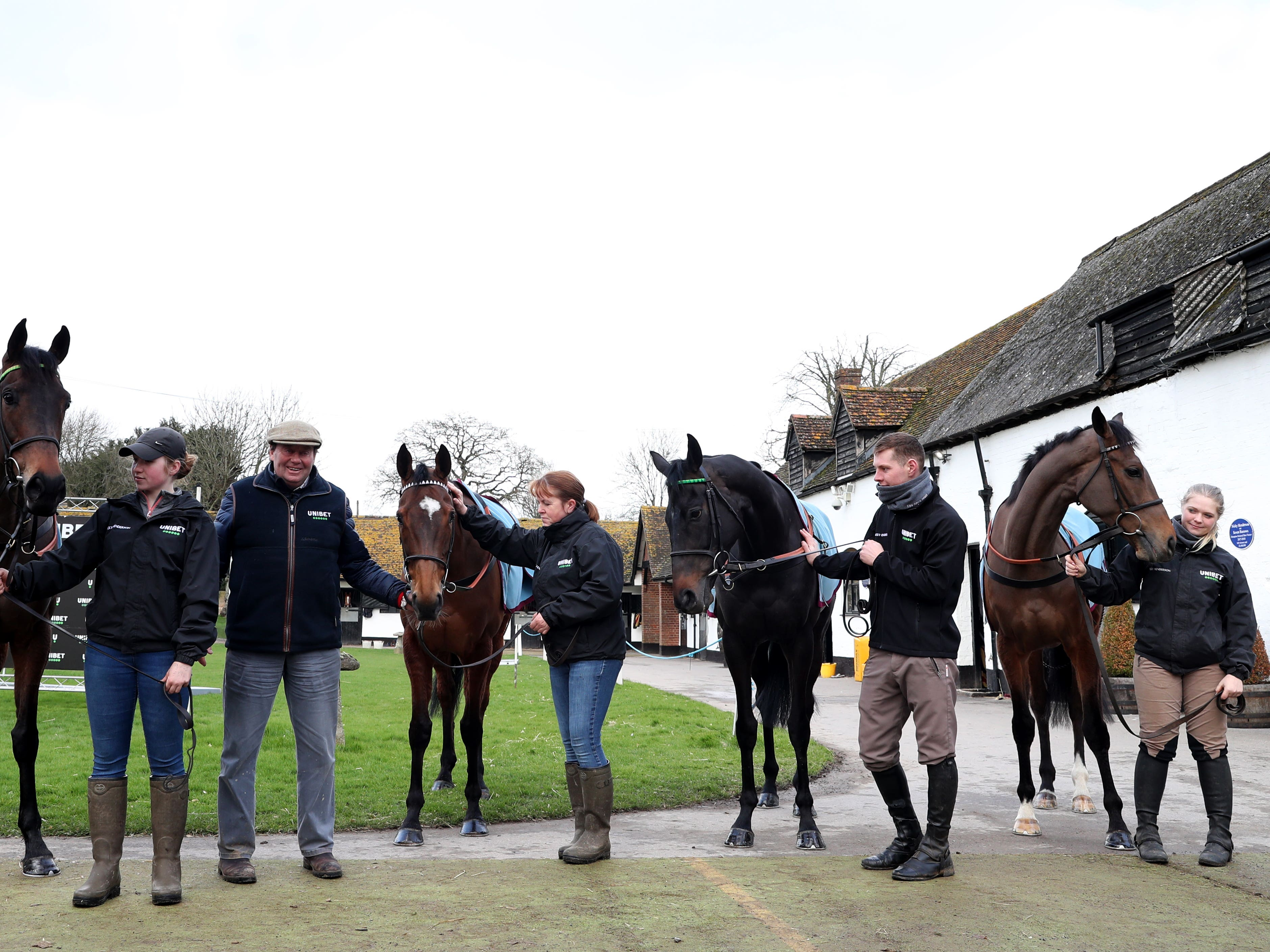 Nicky Henderson shows off four of his Unibet Champion hurdle entries (left to right) Epatante, Verdana Blue, Call Me Lord and Pentland Hills in front of the media (Bradley Collyer/PA)