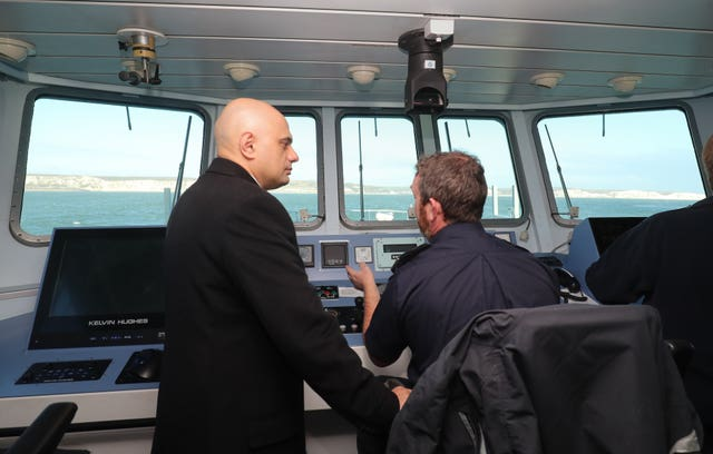 Sajid Javid meets Border Force staff on board HMC Searcher in Dover