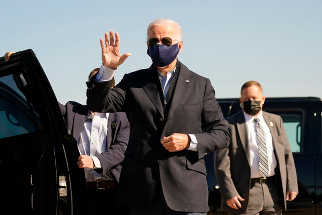 Joe Biden arrives to board his campaign plane in Delaware