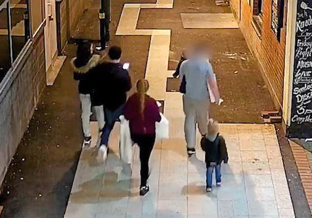 Video grab taken from CCTV of Stephen Waterson and Adrian Hoare, left, with Alfie Lamb, right, with the other people who were in the car, returning from a shopping trip to Sutton on the day Alfie died