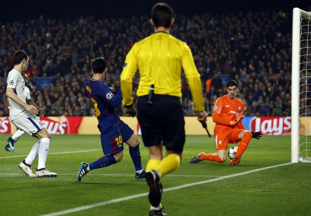 Lionel Messi squeezes in the first goal
