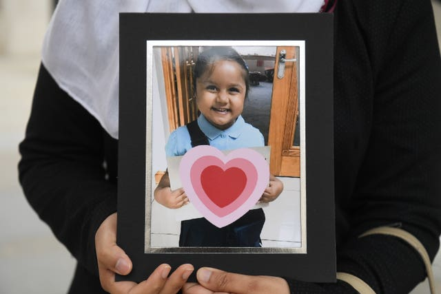 Shelina Begum holds a picture of her five-year-old daughter Tafida Raqeeb