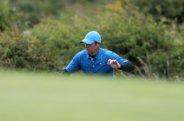 McIlroy looks for his ball on the 5th green