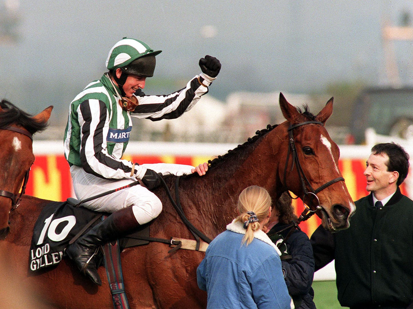 Tony Dobbin and Lord Gyllene celebrate after their victory in the 1997 Grand National (John Giles/PA)